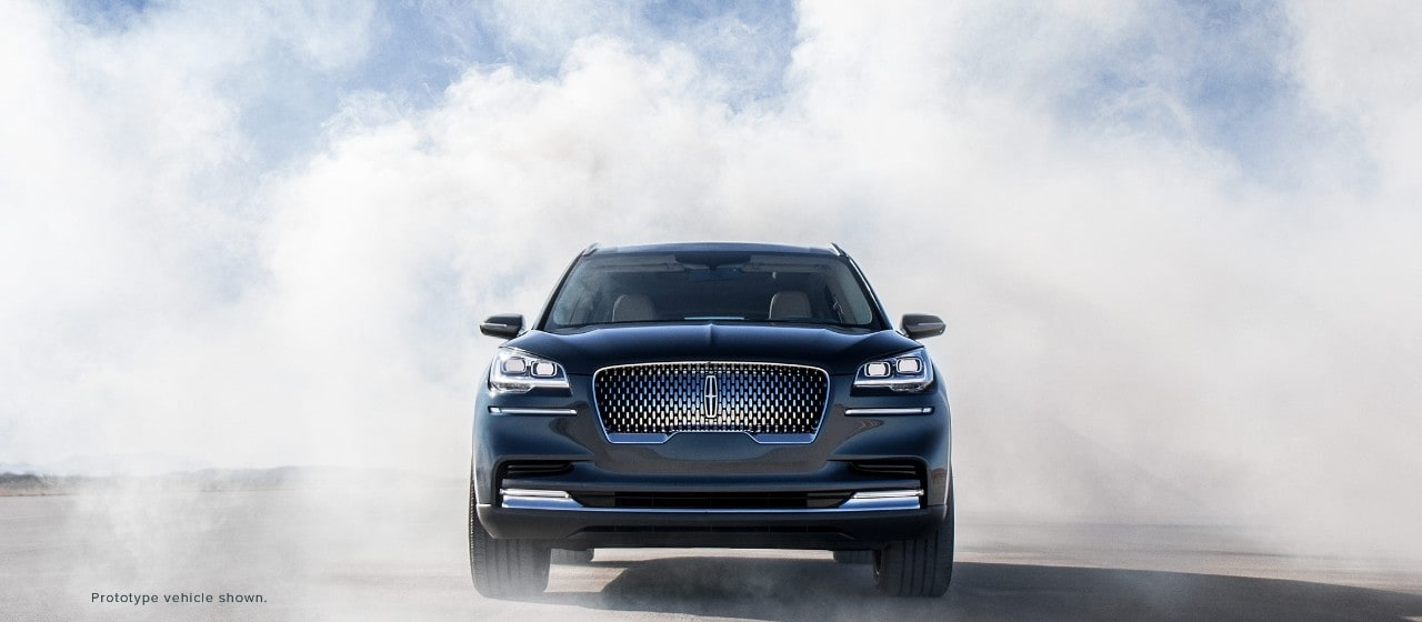 This is an exterior image of the Lincoln Aviator prototype vehicle positioned on a runway as if it is ready to take flight.