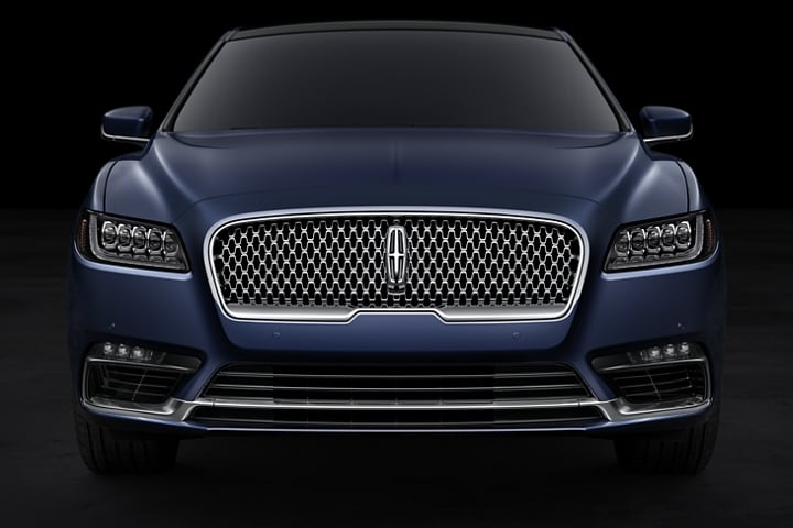 This is a head on shot of the bold grille of a Lincoln Continental with the Rhapsody Blue exterior color